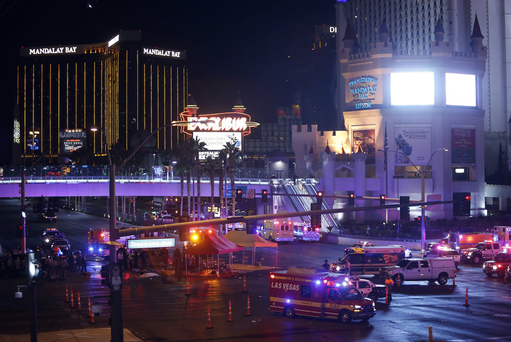 Las Vegas Metro Police and medical workers block off an intersection after a mass shooting at a music festival on the Las Vegas Strip on Sunday, Oct. 1, 2017. (Steve Marcus/AP)