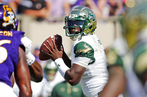 South Florida's Quinton Flowers (9) looks to pass the ball during the second half of an NCAA college football game against East Carolina in Greenville, N.C., Saturday, Sept. 30, 2017. Flowers threw for two touchdowns and ran for another, and No. 18 South Florida extended its school-record winning streak to 10 by routing East Carolina 61-31 on Saturday. (AP Photo/Karl B DeBlaker)
