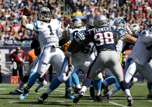Carolina Panthers quarterback Cam Newton (1) passes against the New England Patriots during the first half of an NFL football game, Sunday, Oct. 1, 2017, in Foxborough, Mass. (AP Photo/Steven Senne)