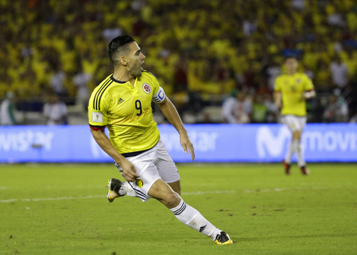 Colombia's Radamel Falcao celebrates after scoring against Paraguay during a 2018 Russia World Cup qualifying soccer match at the Roberto Melendez stadium in Barranquilla, Colombia, Thursday, Oct. 5, 2017. (AP Photo/Fernando Vergara)