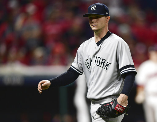 New York Yankees starting pitcher Sonny Gray walks to the dugout after being pulled during the fourth inning against the Cleveland Indians in Game 1 of a baseball American League Division Series, Thursday, Oct. 5, 2017, in Cleveland. Gray pitched 3 1/3 innings and gave up three hits and three runs. (AP Photo/David Dermer)