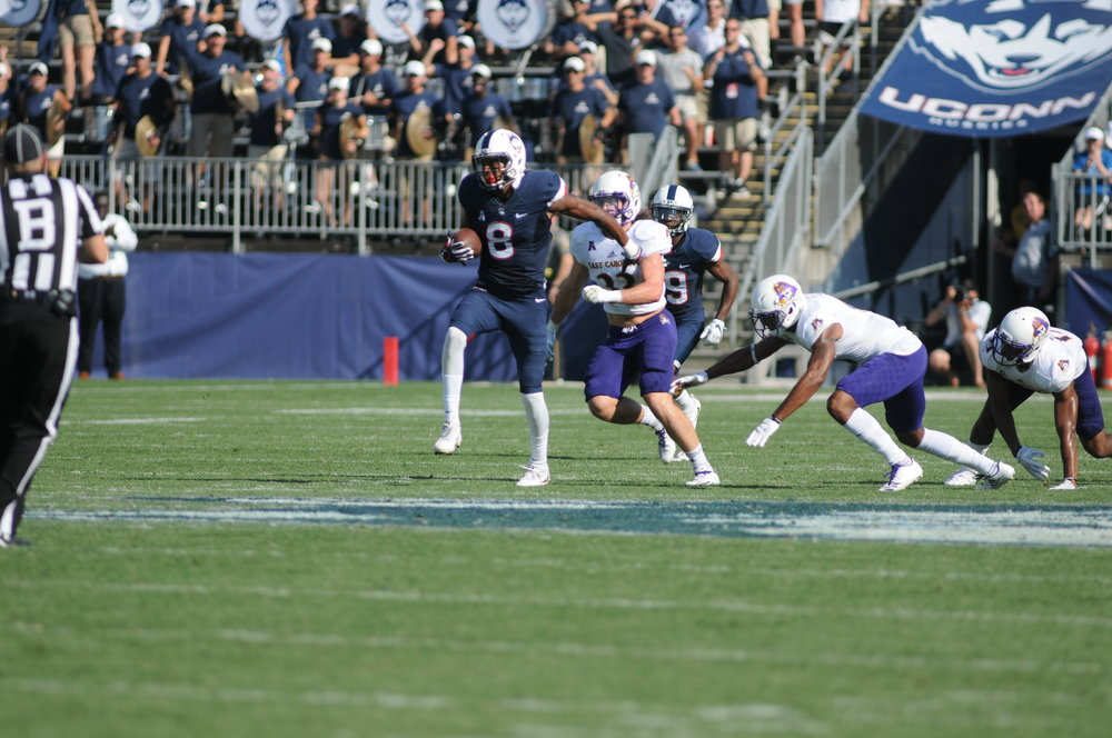 Uconn football wide receiver Aaron McClean (8) powers through ECU during their game on September 24, 2017 at Rentschler Field, East Hartford, Connecticut (Jon Sammis/The Daily Campus)
