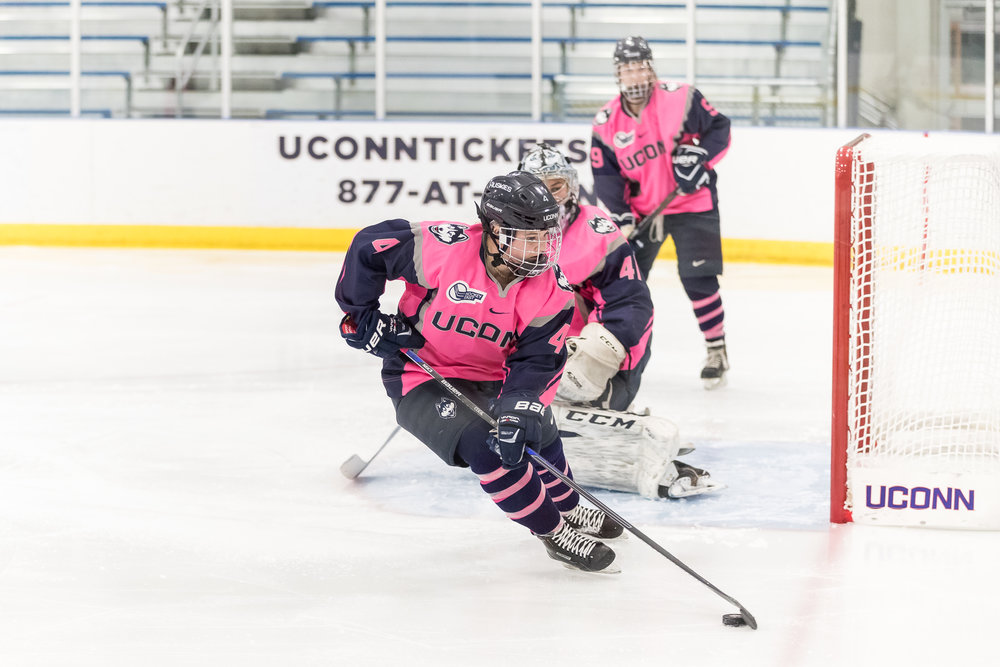 UConn Women's Hockey defender Cidnee Cook (4) gets the puck in the game against Northeastern University. The UConn Huskies lost 3-2 in the Freitas Ice Forum in Storrs, CT on Friday, Jan 20, 2017. (File/The Daily Campus)