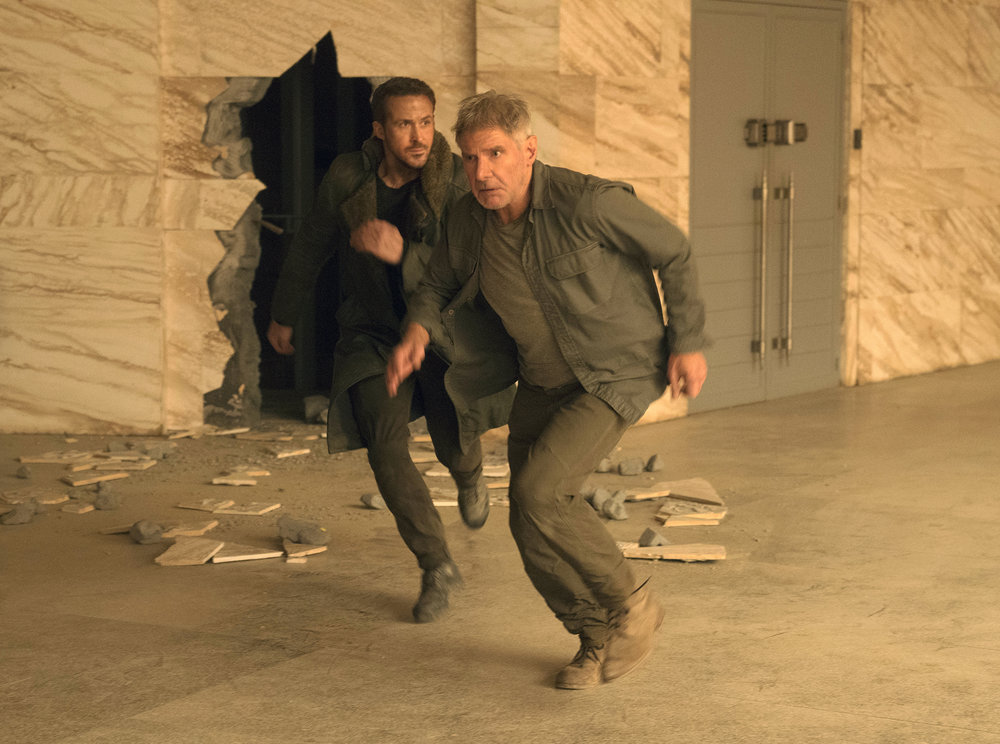 "This image released by Warner Bros. Pictures shows Ryan Gosling, left, and Harrison Ford in a scene from ""Blade Runner2049."" (Stephen Vaughan/Warner Bros. Pictures via AP)"