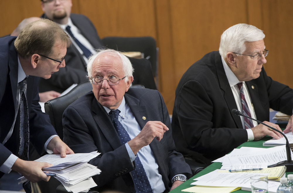 Sen. Bernie Sanders, I-Vt., the ranking member of the Senate Budget Committee, is joined at right by Chairman Mike Enzi, R-Wyo., as members vote on amendments during the markup of Senate's fiscal year 2018 budget resolution, on Capitol Hill in Washington, Thursday, Oct. 5, 2017. (AP Photo/J. Scott Applewhite)