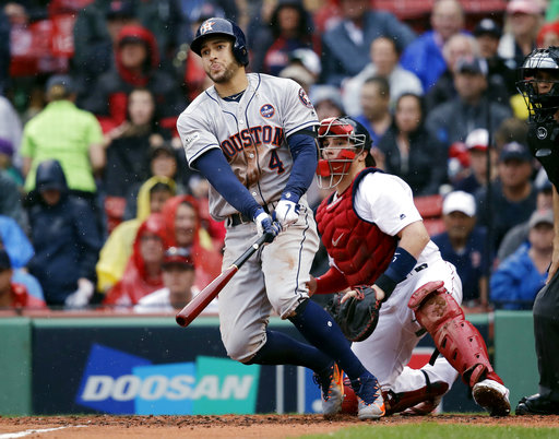 Houston Astros' George Springer watches his RBI single in front of Boston Red Sox catcher Christian Vazquez, right, second inning of Game 4 of baseball's American League Division Series, Monday, Oct. 9, 2017, in Boston. (AP Photo/Charles Krupa)