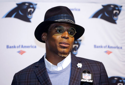 "In this Oct. 1, 2017, file photo, Carolina Panthers quarterback Cam Newton speaks to the media following an NFL football game against the Carolina Panthers, in Foxborough, Mass. Dannon, the maker of Oikos yogurt, is cutting ties with spokesman Cam Newton following what the company perceives as ""sexist"" comments the Carolina quarterback made to a female reporter. (AP Photo/Steven Senne, File)"