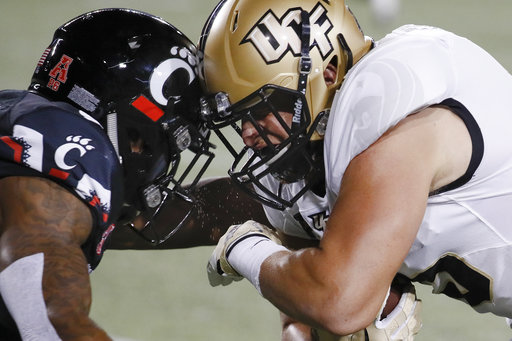 UCF tight end Jordan Franks, right, collides head-to-head with Cincinnati cornerback Linden Stephens, left, in the first half of an NCAA college football game, Saturday, Oct. 7, 2017, in Cincinnati. (AP Photo/John Minchillo)