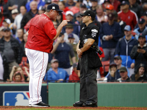 In this Monday, Oct. 9, 2017, photo, Boston Red Sox manager John Farrell, left, argues with home plate umpire Mark Wegner, right, during the second inning of Game 4 of baseball's American League Division Series against the Houston Astros in Boston. (AP Photo/Charles Krupa)