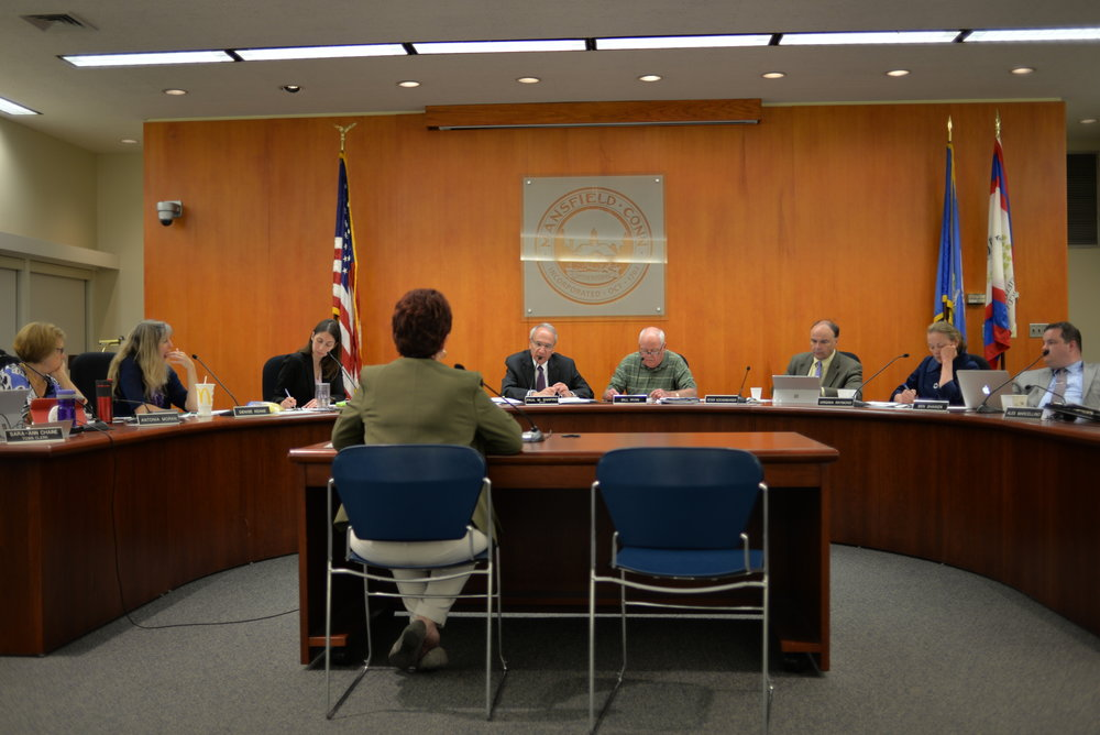 The Mansfield Town Council discusses the potential upcoming budget cuts and general changes to the town budget during their weekly meeting on Tuesday, Oct. 10, 2017 in the Mansfield Town Hall. (Amar Batra/ The Daily Campus)