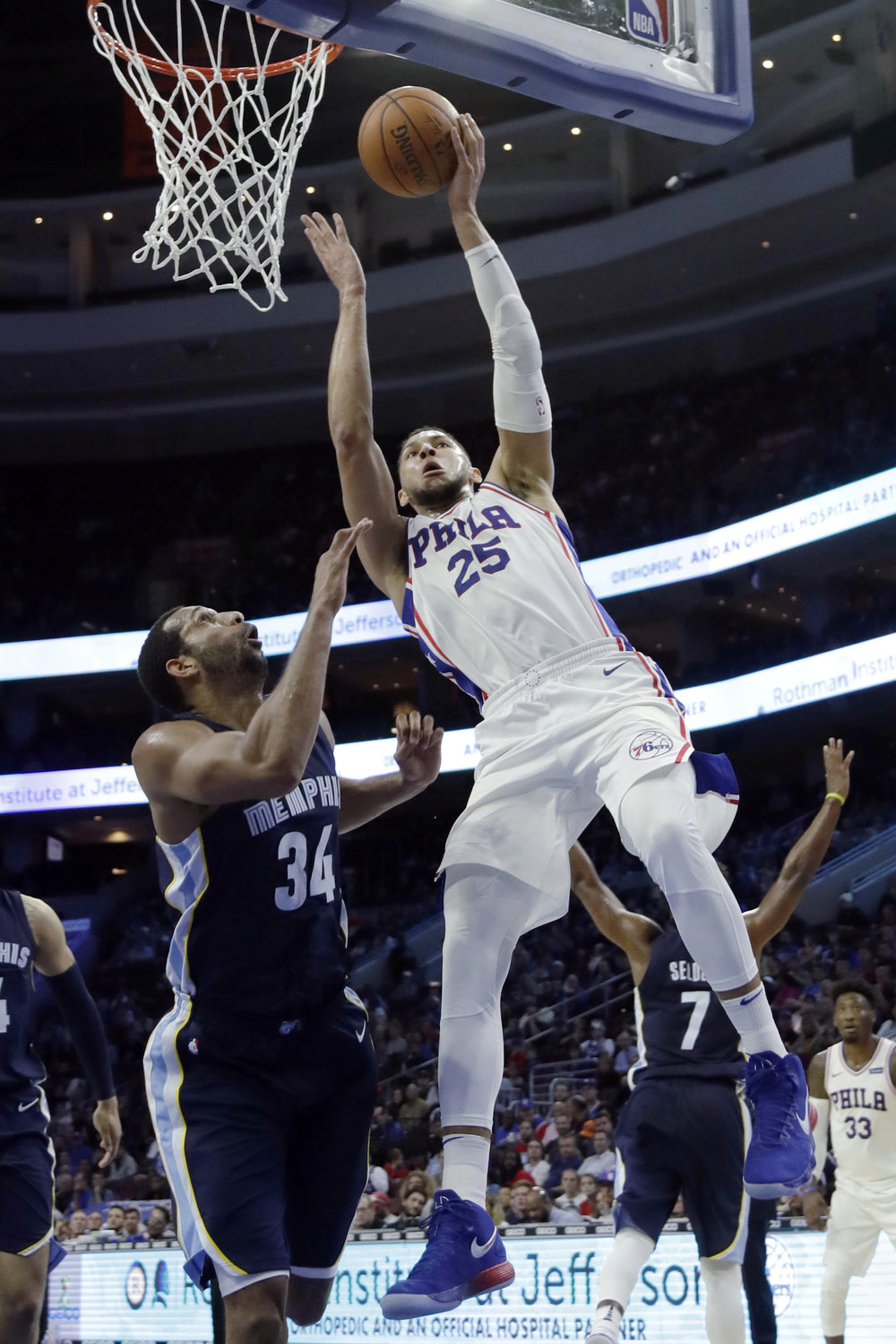 Philadelphia 76ers' Ben Simmons, right, goes up for a shot against Memphis Grizzlies' Brandan Wright during the second half of a preseason NBA basketball game, Wednesday, Oct. 4, 2017, in Philadelphia. (AP Photo/Matt Slocum)