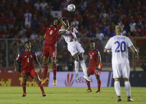 Panama's Gabriel Gomez, left, and Costa Rica's Rodney Wallace fight for the ball during a 2018 Russia World Cup qualifying soccer match in Panama City, Tuesday, Oct. 10, 2017. (AP Photo/Arnulfo Franco)