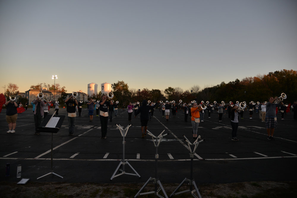 Members of the UCMB feel the band is more than just a source of entertainment at football games: it's a family. (Amar Batra/The Daily Campus)