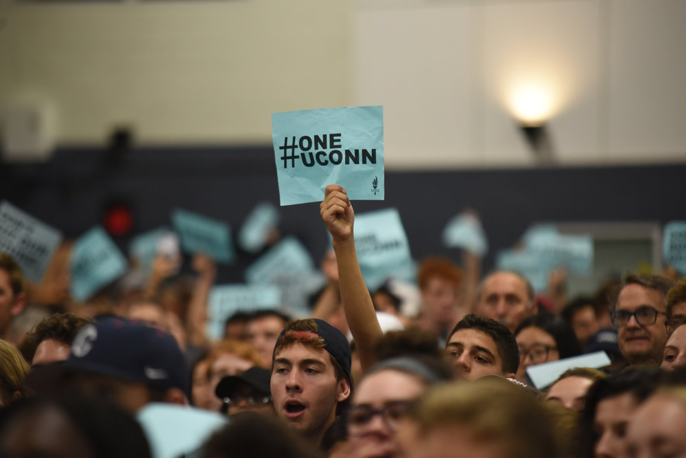 Students and faculty join together in a rally to #SaveUConn in the face of upcoming budget cut on Sept. 20, 2017 in the Greer Field House. (Charlotte Lao/The Daily Campus)