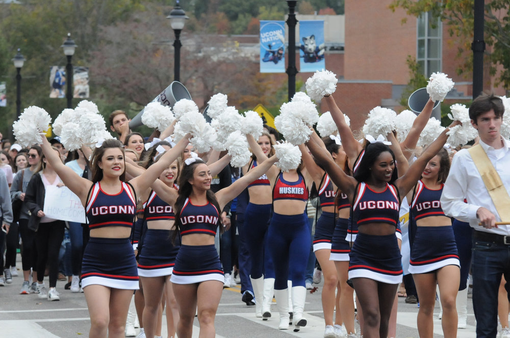 The UConn cheer team marched in the parade along with those in Greek life, dance team, and many other associations.  (Olivia Stenger/The Daily Campus)