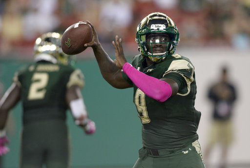 South Florida quarterback Quinton Flowers (9) throws the ball during the second half of an NCAA college football game against Cincinnati Saturday, Oct. 14, 2017, in Tampa, Fla. (AP Photo/Jason Behnken)