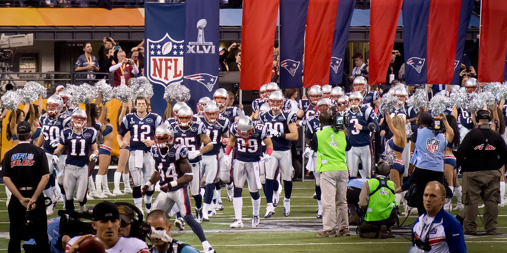 Tom Brady and the New England Patriots come out to the field before Super Bowl XLVI. (Saboteur/Flickr, Creative Commons)
