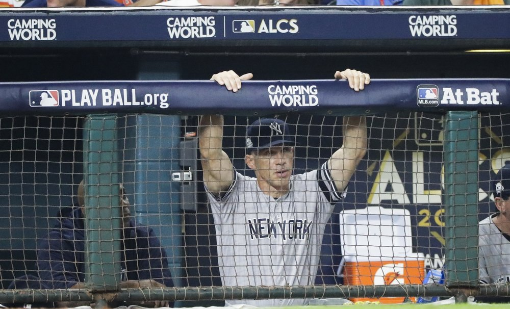 New York Yankees manager Joe Girardi watches during the fourth inning of Game 1 of baseball's American League Championship Series against the Houston Astros Friday, Oct. 13, 2017, in Houston. (AP Photo/David J. Phillip)
