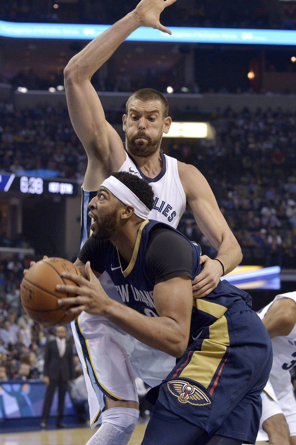 New Orleans Pelicans forward Anthony Davis, bottom, drives against Memphis Grizzlies center Marc Gasol during the first half of an NBA basketball game Wednesday, Oct. 18, 2017, in Memphis, Tenn. (Brandon Dill/AP)