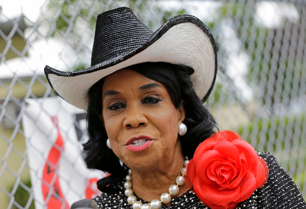 "In this Wednesday, Oct. 18, 2017, file photo, Rep. Frederica Wilson, D-Fla., talks to reporters in Miami Gardens, Fla. Wilson is asking White House Chief of Staff John Kelly to apologize for making false claims about her while defending President Donald Trump's handling of condolences to a military family. Wilson on Sunday, Oct. 22, called Kelly a ""puppet of the president"" and accused him of character assassination. (AP Photo/Alan Diaz, File)"