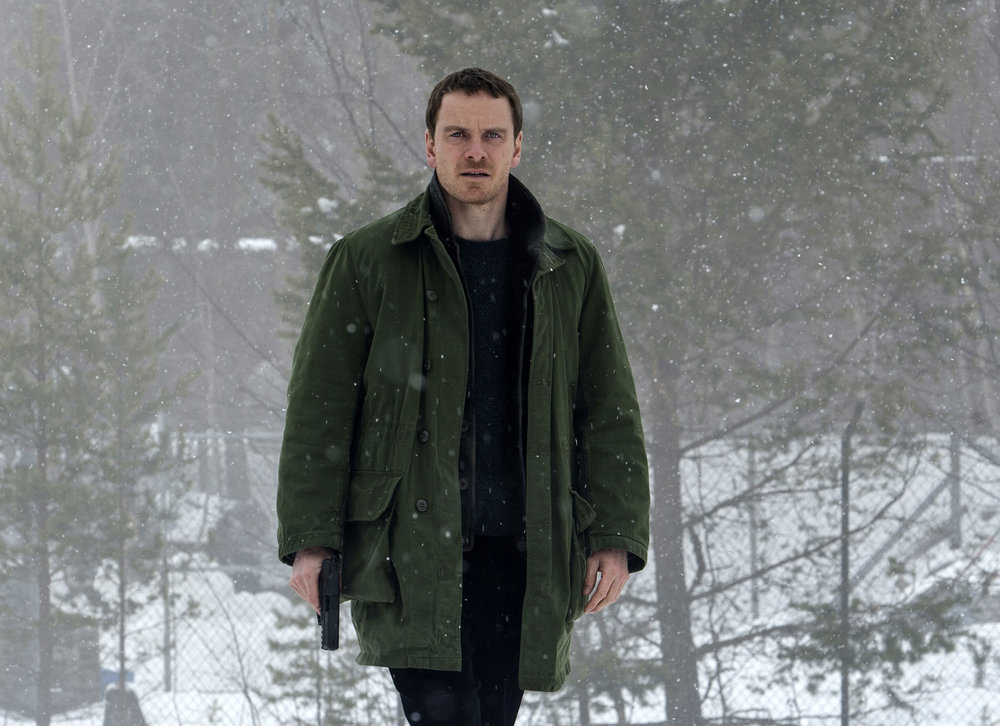 "This image released by Universal Pictures shows Michael Fassbender in the thriller ""The Snowman."" (Jack English/Universal Pictures via AP)"