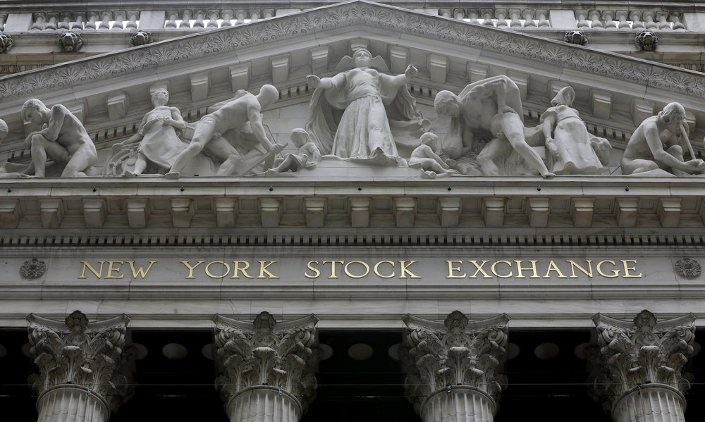 This Thursday, Oct. 2, 2014, file photo, shows the facade of the New York Stock Exchange. U.S. stocks were up slightly in early trading Friday, Oct. 20, 2017, as investors cheered a crop of strong company earnings. (AP Photo/Richard Drew, File)