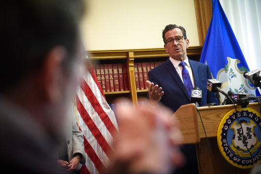 "Connecticut Gov. Dannel Malloy speaks with reporters Wednesday, Oct. 18, 2017, during a press conference in Hartford, Conn., held in response to house and senate leaders announced a bipartisan budget deal was close to completion. ""I think it's progress, "" said Malloy, in the absence of an actual budget, ""it's very difficult to celebrate."" (Mark Mirko /The Courant via AP)"