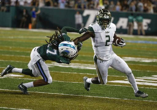 South Florida running back D'Ernest Johnson (2) stiff-arms Tulane cornerback Parry Nickerson (17) on a run during the second half of an NCAA college football game in New Orleans, La., Saturday, Oct. 21, 2017. (AP Photo/Derick E. Hingle)
