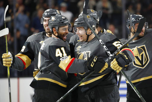 Vegas Golden Knights' Pierre-Edouard Bellemare, left, celebrates with David Perron after Perron made the game-winning goal during overtime of an NHL hockey game against the Buffalo Sabres, Tuesday, Oct. 17, 2017, in Las Vegas. Vegas is 6-1-0 in their first seven games. (AP Photo/John Locher)