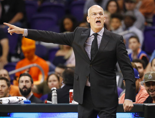 Phoenix Suns head coach Jay Triano yells during the first half of an NBA basketball game against the Sacramento Kings, Monday, Oct. 23, 2017, in Phoenix. It was Triano's first game as the Suns' head coach. (AP Photo/Matt York)