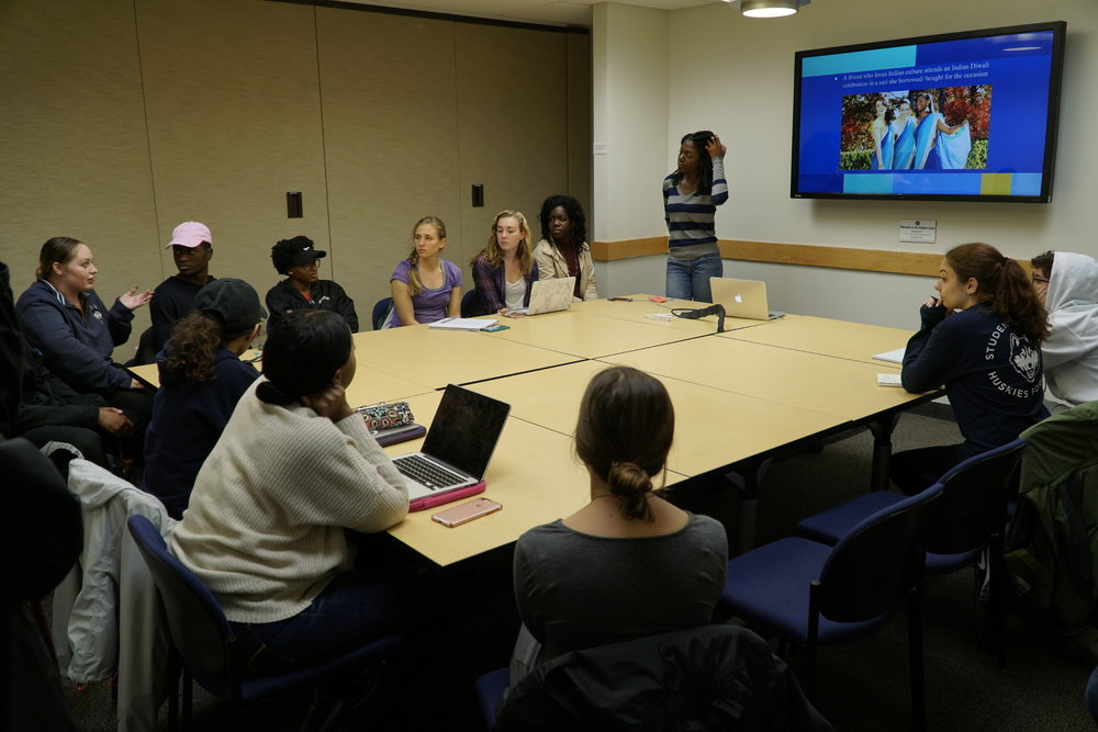 Students from the Honors for Diversity group discuss the lines between cultural appropriation and appreciation through pop song music videos and social media posts. (Eric Wang/ The Daily Campus)