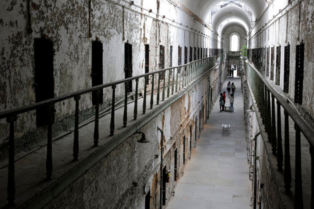 "In this Sept. 27, 2013, file photo, Eastern State Penitentiary in Philadelphia is shown. The penitentiary took in its first inmate in 1829, closed in 1971 and reopened as a museum in 1994. The site is mentioned in the book ""Ghostland: An American History in Haunted Places."" (AP Photo/Matt Rourke, File)"