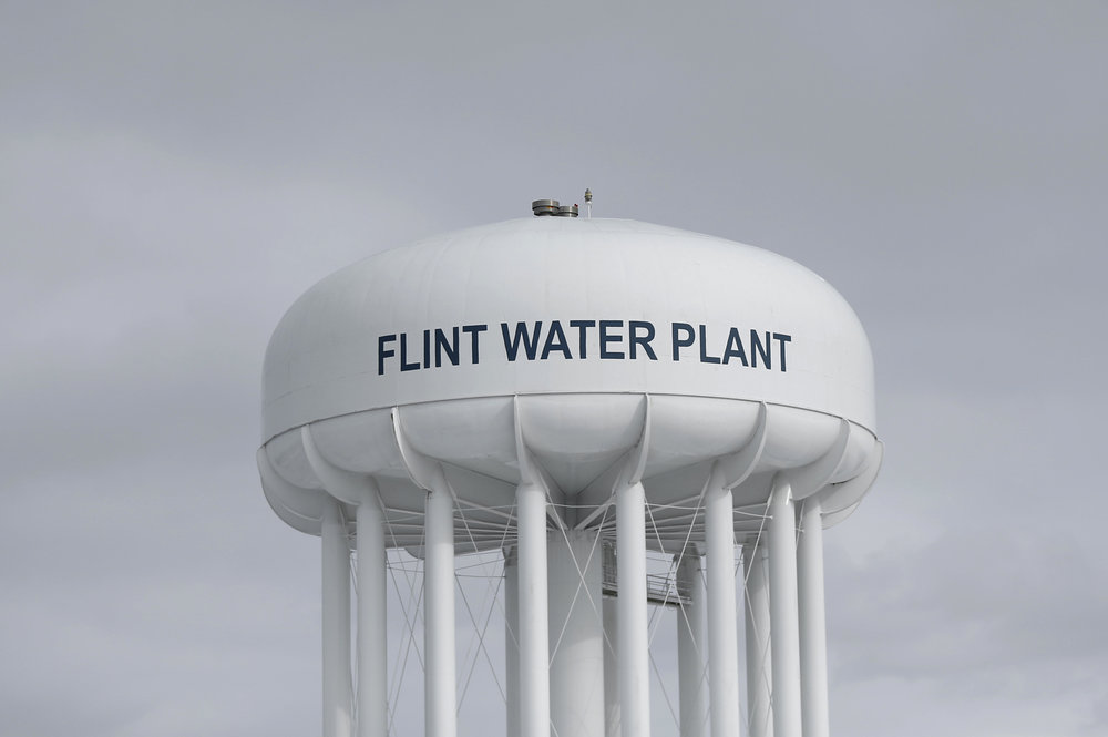 The Flint Water Plant tower stands in Flint, Mich. The City Council voted Monday, Oct. 23, 2017, to extend a short-term contract for drinking water after requesting more time to comply with a federal judge's order to choose a long-term water source. (Paul Sancya, File/AP)