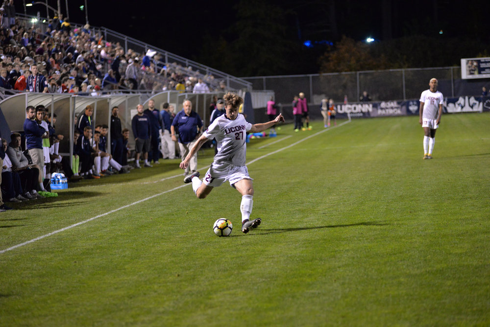 UConn senior Andrew Geres sends a ball down the field during the Huskies 3-2 loss to UCF on Saturday, Oct. 21, 2017 at Morrone Stadium. Geres and the rest of the seniors will be honored at Saturday's game. (Amar Batra/The Daily Campus)