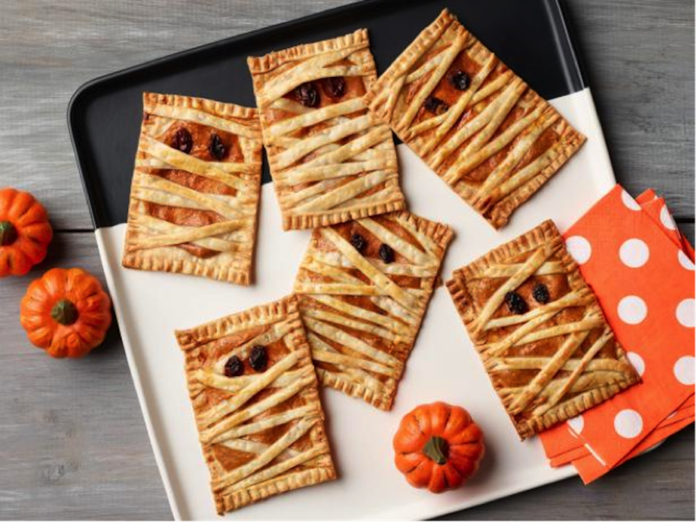This week on Melissa's Menu mummy hand pies, a Halloween-themed dessert. On the outside is a crispy pastry dough in a crisscross pattern to give the bandaged-up mummy effect and the inside has a warm pumpkin filling. (Photo courtesy of Delish.com)