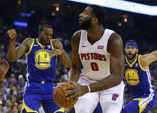 Detroit Pistons' Andre Drummond (0) looks to shoot against Golden State Warriors' Andre Iguodala, left, and JaVale McGee during the first half of an NBA basketball game Sunday, Oct. 29, 2017, in Oakland, Calif. (AP Photo/Ben Margot)
