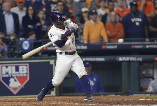 Houston Astros' Jose Altuve hits an RBI double during the seventh inning of Game 5 of baseball's World Series against the Los Angeles Dodgers Sunday, Oct. 29, 2017, in Houston. (AP Photo/David J. Phillip)