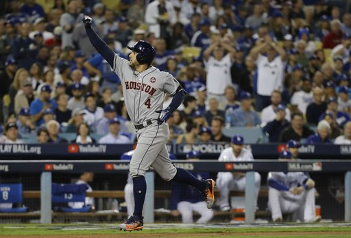 Houston Astros' George Springer hits a home run during the third inning of Game 6 of baseball's World Series against the Los Angeles Dodgers Tuesday, Oct. 31, 2017, in Los Angeles. (AP Photo/David J. Phillip)