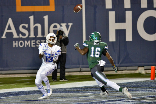Memphis wide receiver Kedarian Jones (13) catches a pass for a touchdown ahead of Tulane safety P.J. Hall (16) in the first half of an NCAA college football game Friday, Oct. 27, 2017, in Memphis, Tenn. (AP Photo/Brandon Dill)