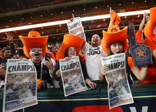 David Arriasola, from left, Jennifer Reyna, Jesse Montalvo and Debbie Brannon celebrate after the Houston Astros won Game 7 of baseball's World Series between the Los Angeles Dodgers and the Astros at at Minute Maid Park in Houston on Wednesday, Nov. 1, 2017. (Jon Shapley/Houston Chronicle via AP)