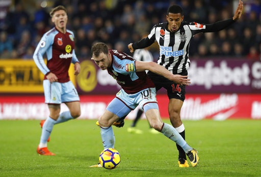 Burnley's Ashley Barnes, left, and Newcastle United's Isaac Hayden battle for the ball during the English Premier League soccer match Burnley versus Newcastle at Turf Moor, Burnley, England, Monday Oct. 30, 2017. (Martin Rickett/PA via AP)