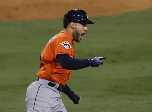 Houston Astros' George Springer (4) celebrates after his two-run home run against the Los Angeles Dodgers during the second inning of Game 7 of baseball's World Series Wednesday, Nov. 1, 2017, in Los Angeles. (AP Photo/Alex Gallardo)