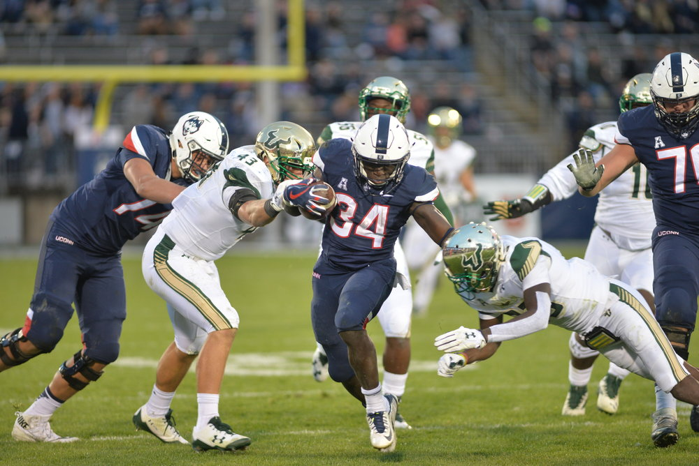 Freshman running back Kevin Mensah in action against the Bulls' defense (Amar Batra/The Daily Campus)