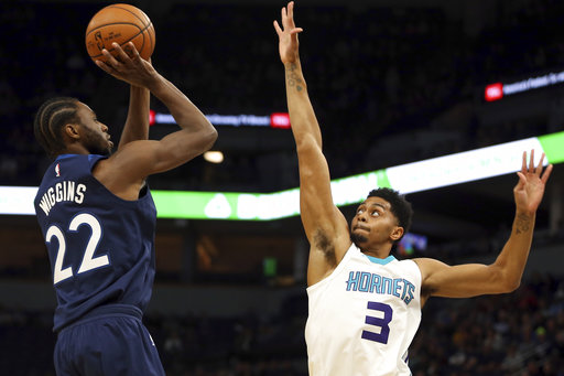 Minnesota Timberwolves forward Andrew Wiggins (22) lines up a shot against Charlotte Hornets guard Jeremy Lamb (3) in the first half of an NBA basketball game Sunday, Nov. 5, 2017, in Minneapolis. (AP Photo/Stacy Bengs)