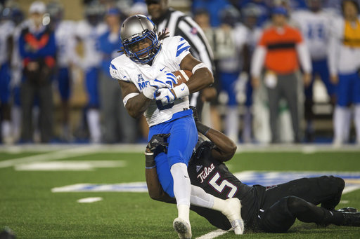 Tulsa safety McKinley Whitfield (5) drags down Memphis running back Darrell Henderson during an NCAA college football game Friday, Nov. 3, 2017, in Tulsa, Okla. (Brett Rojo/Tulsa World via AP)