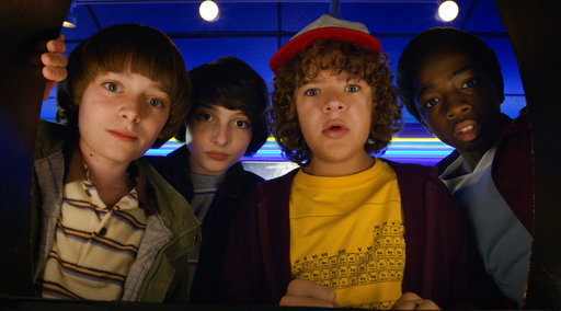 "This image released by Netflix shows Noah Schnapp, from left, Finn Wolfhard, Gaten Matarazzo and Caleb Mclaughlin in a scene from ""Stranger Things."". (Netflix via AP)"