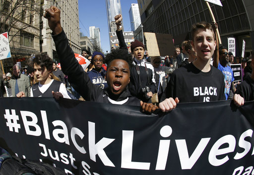 In this April 15, 2017 file photo, young protesters take part in a Black Lives Matter march in Seattle. (AP Photo/Ted S. Warren, File)