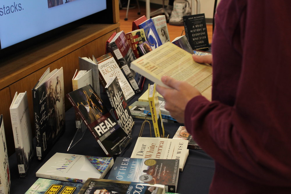 Homer Babbidge librarians compiled various texts into the Diversity Bookshelf: The Story of Race in Books on Wednesday. (Kimberly Nguyen/The Daily Campus)