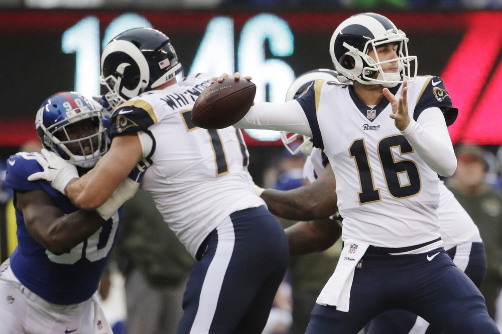 FILE - In this Sunday, Nov. 5, 2017, file photo, Los Angeles Rams' Jared Goff throws a pass during the second half of an NFL football game against the New York Giants in East Rutherford, N.J. Goff's rough rookie season is fading into memory with each outstanding performance this fall for the surging Rams.  (Julio Cortez, File/AP)