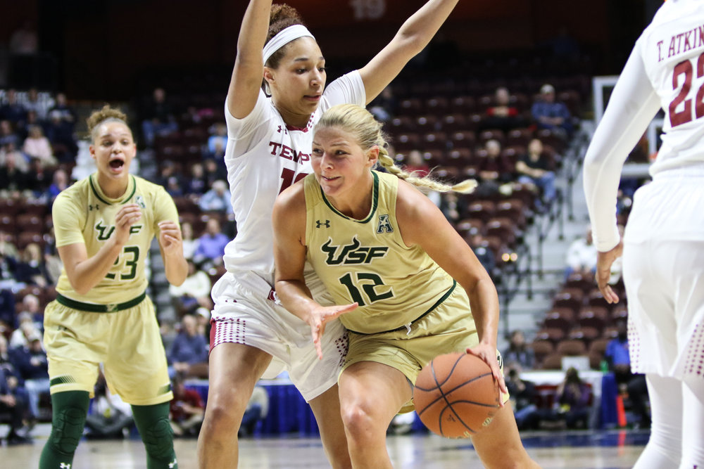USF forward Maria Jespersen drives past a Temple defender in the first half of the Bulls' 63-58 win over the Owls on Sunday night in the American semifinals at Mohegan Sun Arena in Uncasville. USF will play UConn in the American Conference final on Monday night at 7 p.m.. (Jackson Haigis/The Daily Campus)